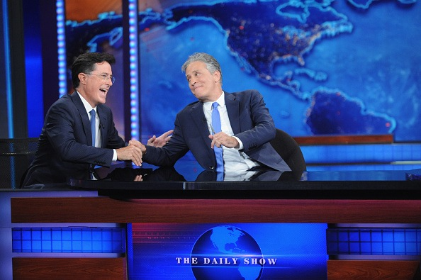 "NEW YORK, NY - AUGUST 06: Stephen Colbert and Jon Stewart appear on ""The Daily Show with Jon Stewart"" #JonVoyage on August 6, 2015 in New York City. (Photo by Brad Barket/Getty Images for Comedy Central)"