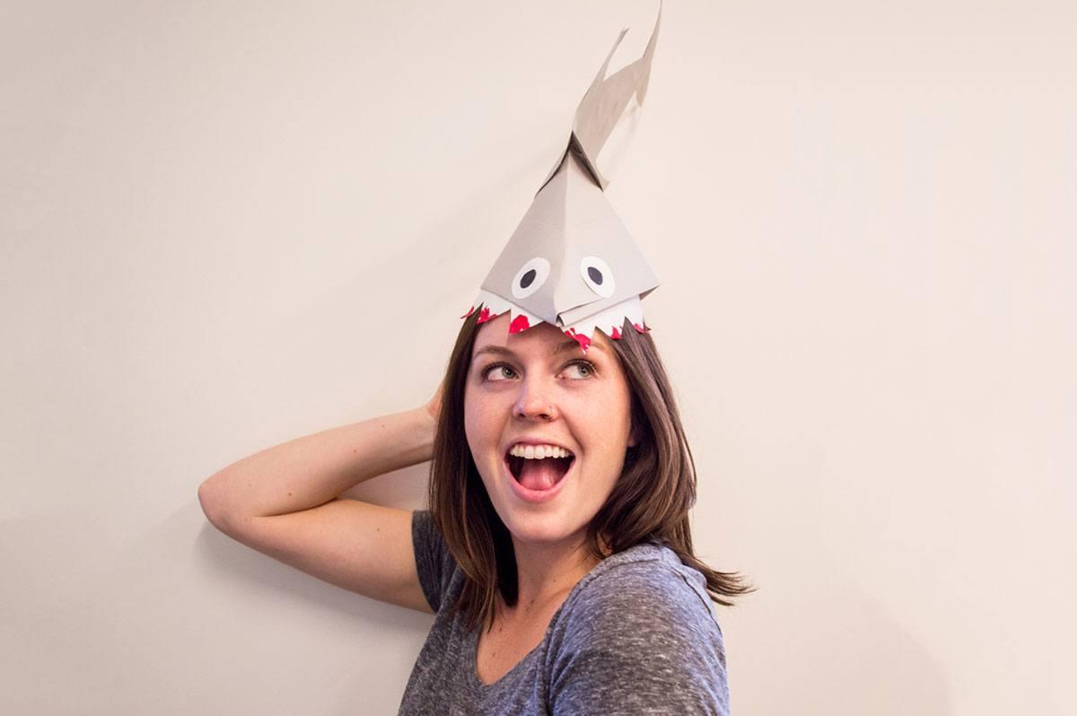 happy girl wearing shark hat