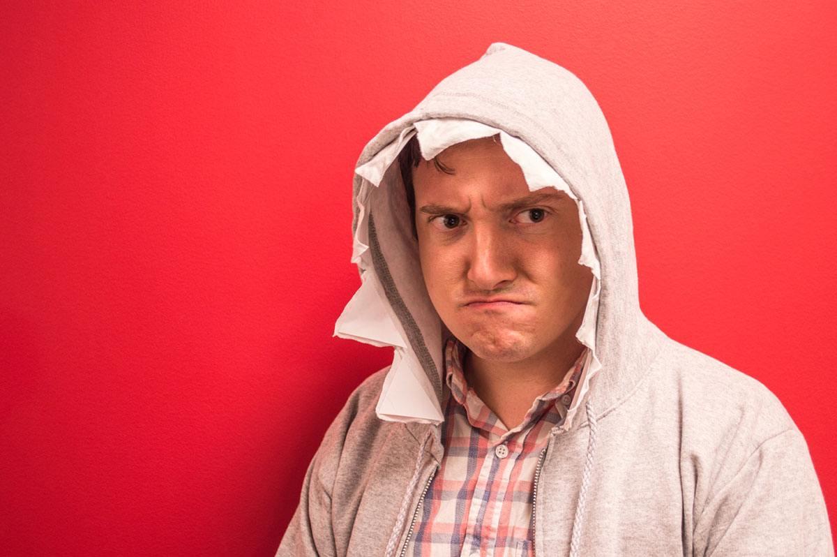 grumpy man wearing shark hoodie