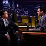 Jimmy Fallon and Stephen Colbert sitting and staring